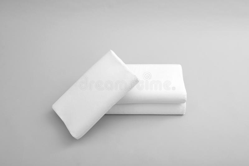 Clean soft orthopedic pillows. On grey background royalty free stock photos