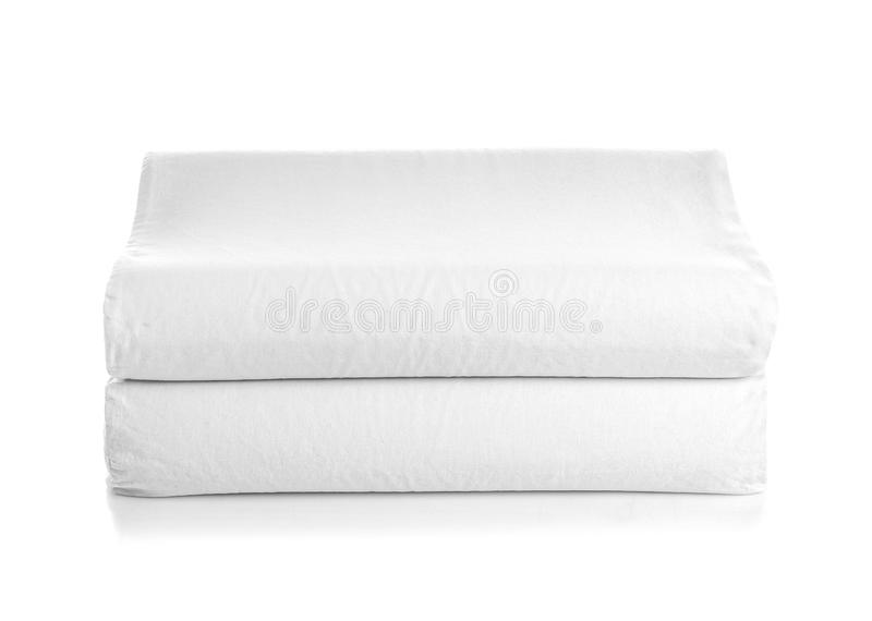 Clean soft orthopedic pillows. On white background stock photography