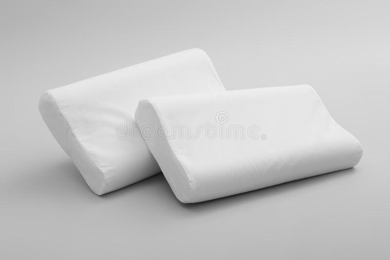 Clean soft orthopedic pillows. On grey background stock photos