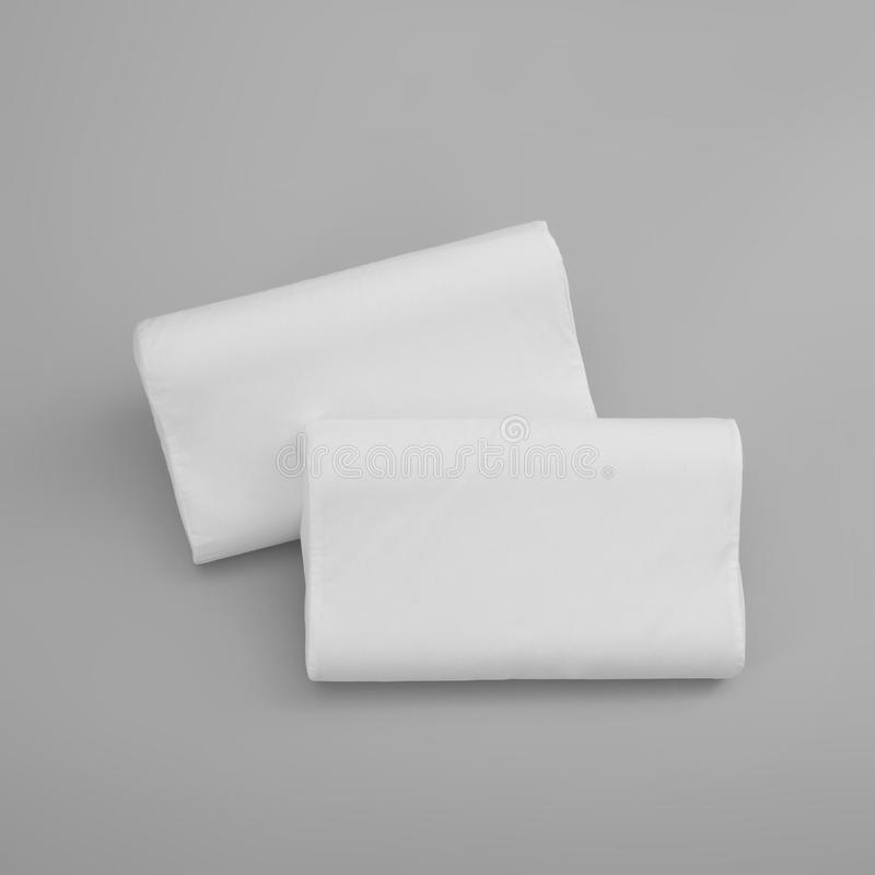 Clean soft orthopedic pillows. On grey background, top view royalty free stock photos
