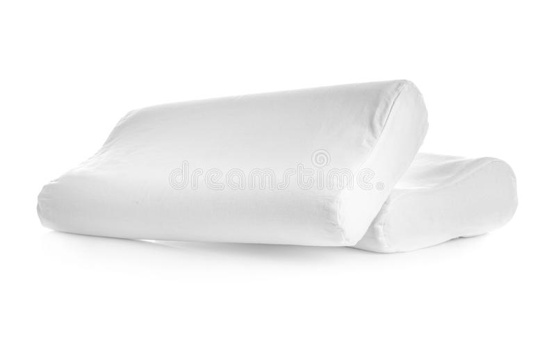 Clean soft orthopedic pillows. On white background royalty free stock photography