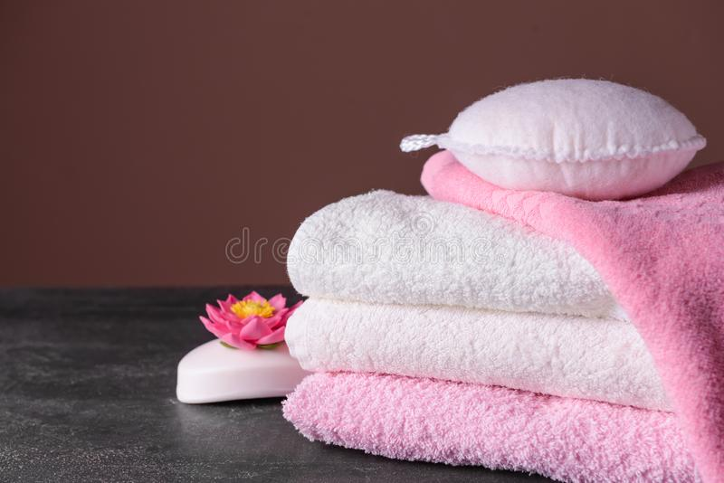 Clean soft towels, soap and wisp on grey table stock photos