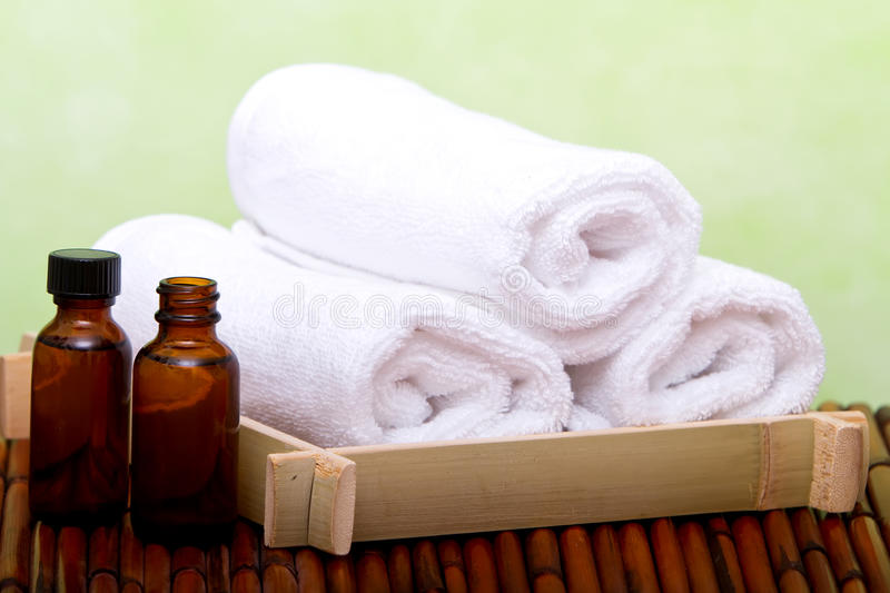 Clean spa towels and essential oil royalty free stock photography