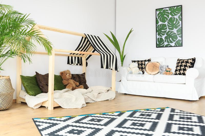 Clean space in kids room. Clean tranquil open space in natural bright kids room royalty free stock photos