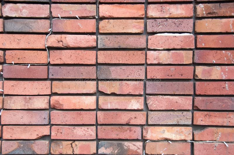 Clean symmetry neat orange brick wall background royalty free stock photography