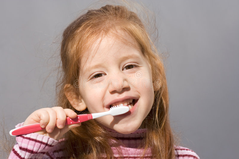 Clean teeth of pretty child stock images