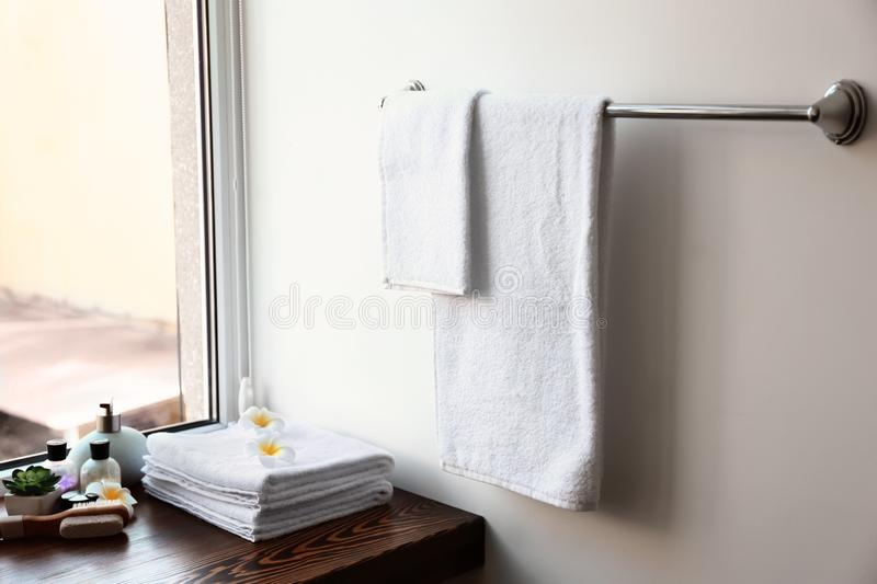 Clean towels and cosmetics in bathroom stock photography