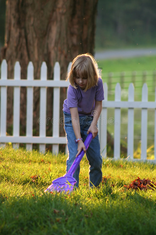 Clean up the World One Yard at a Time. A young girl does her part in cleaning up the world and keeping the environment clean