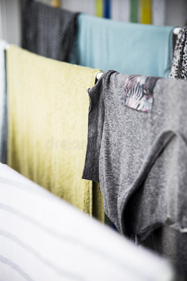 Clean washed laundry is dried in the house royalty free stock photos