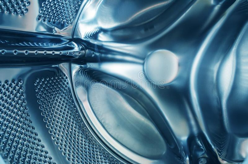 Clean washing machine inside, drum closeup empty royalty free stock image
