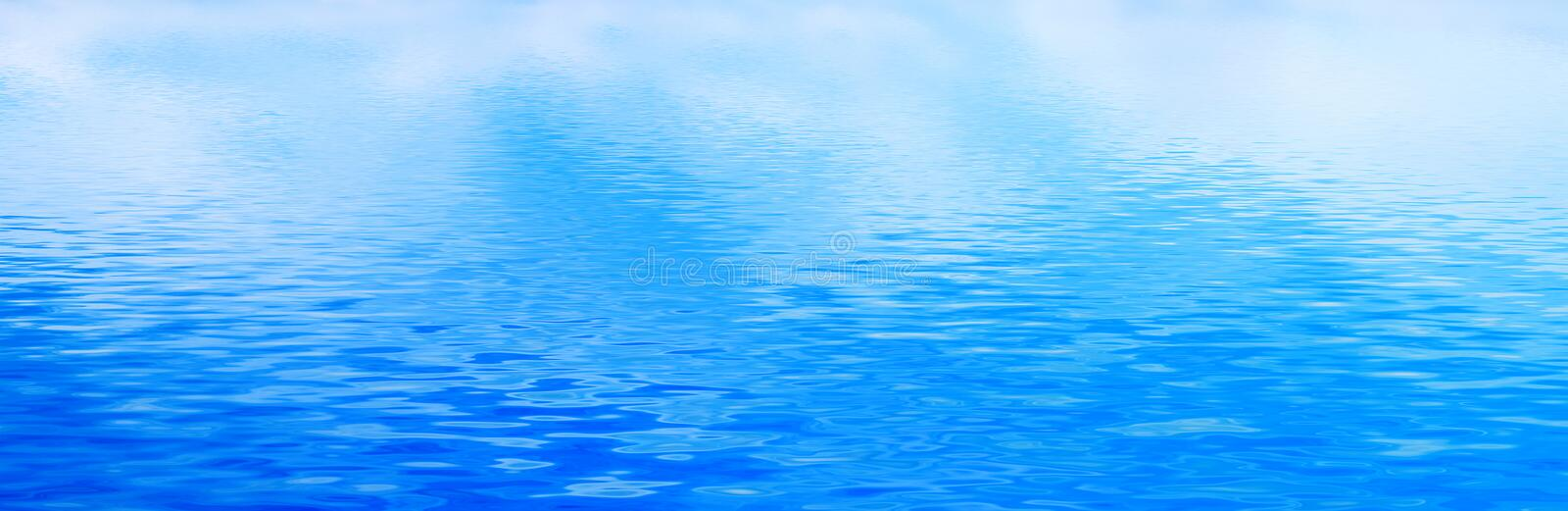 Clean water background, calm waves. Banner, panorama. Clean water background with calm waves. Blue sky reflection. Banner, panorama royalty free stock photos