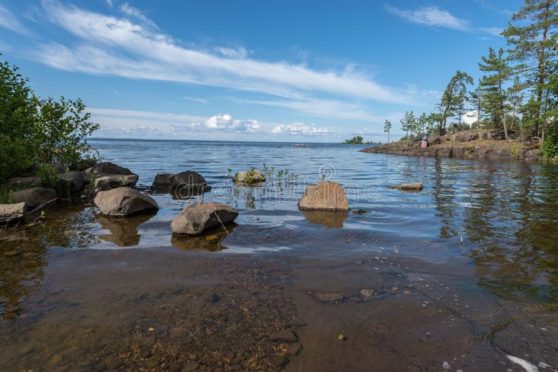 Clean water and rocky bottom of a calm and quiet bay of the island stock image