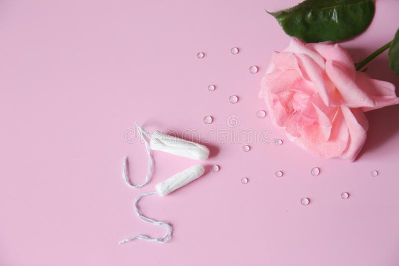 Clean white cotton tampon on pink background with drops. Isolated. Copy space. Menstruation. Feminine Hygiene in periods, beauty. Two clean white cotton tampon royalty free stock photos