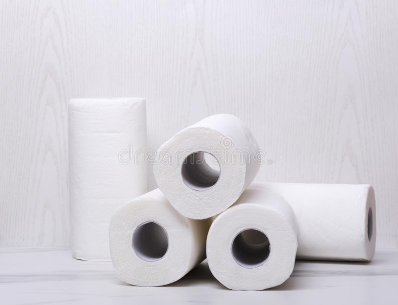 Clean and white paper towels on the marble floor. Pile of rolled soft paper towels stock photography