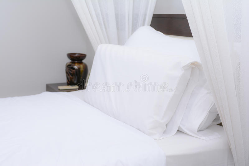 Clean white pillow on the bed royalty free stock photos