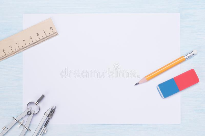 Clean white sheet with drawing tools on a light background stock photography