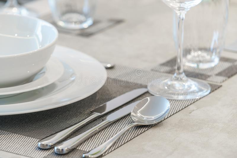 Tableware and napkins on a table royalty free stock image