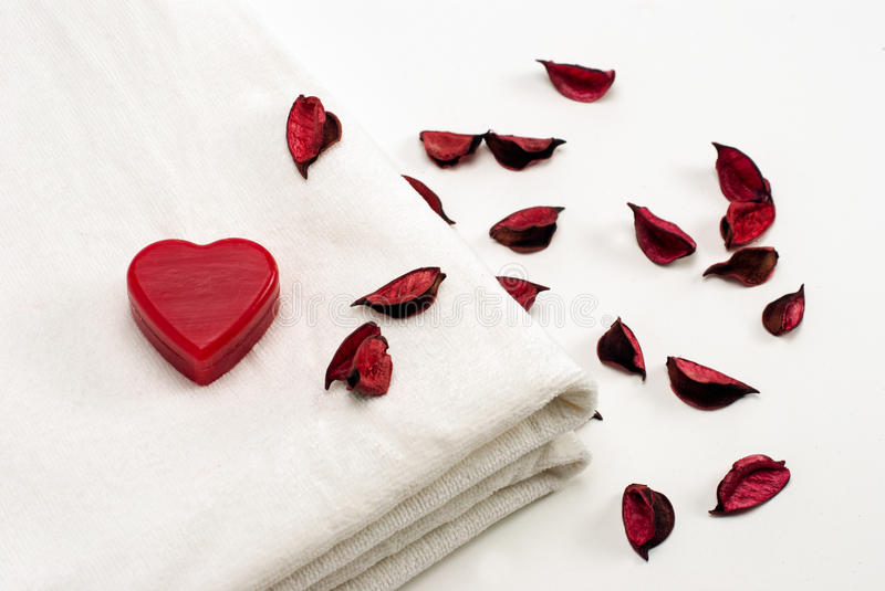 Clean White Towel with Heart Shape Soap and Rose Leafs stock images
