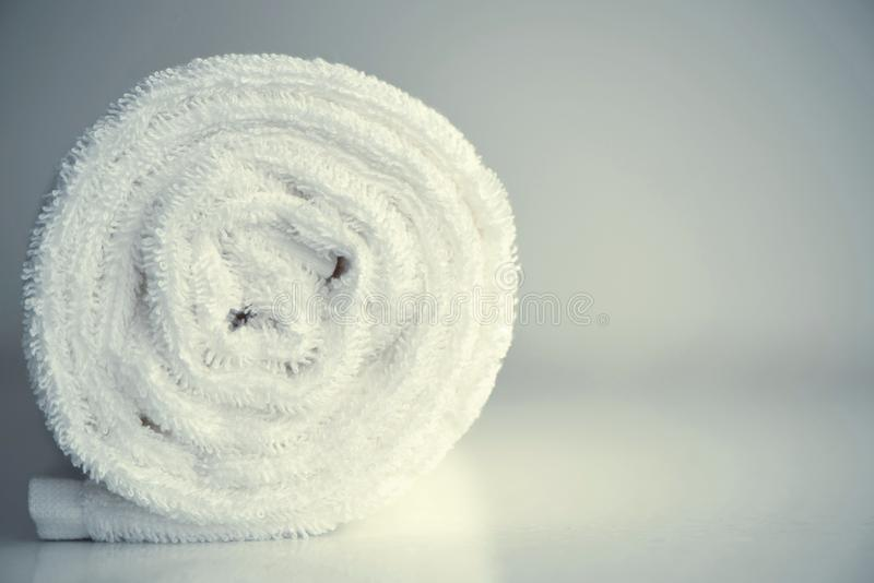 Clean white towel rolled blanket textile on light blurred background royalty free stock images