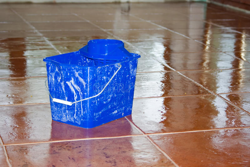 Cleaned new tiles with bucket stock photography