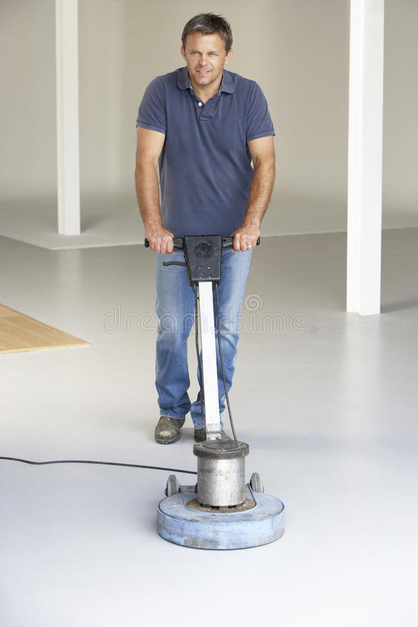 Cleaner polishing office floor stock photography