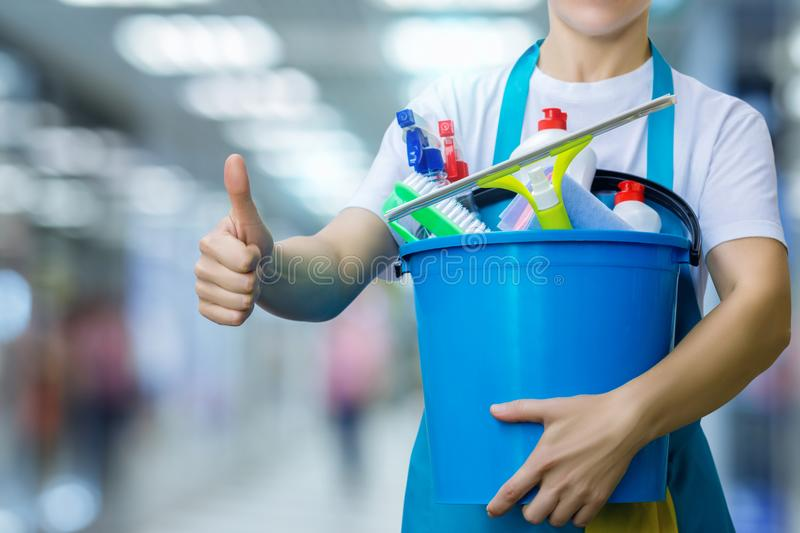 Cleaner shows good. Cleaner with the bucket and cleaning agents shows good stock photo