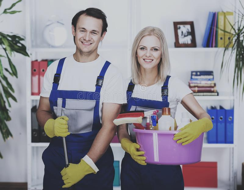 Cleaners with bucket in their hands. stock photo