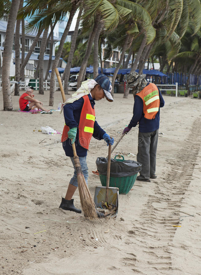 Cleaners clearing the beach of Si Racha from garbage and waste. Si Racha, Thailand - Jul 18, 2015: Cleaners clearing the beach of Si Racha from garbage and waste stock photo
