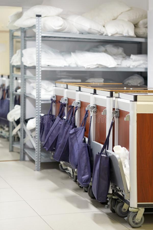 Cleaners trolley at hotel. Cleaners trolley with cleaning equipments at hotel. Hotel linen cleaning services. Hotel laundry stock image