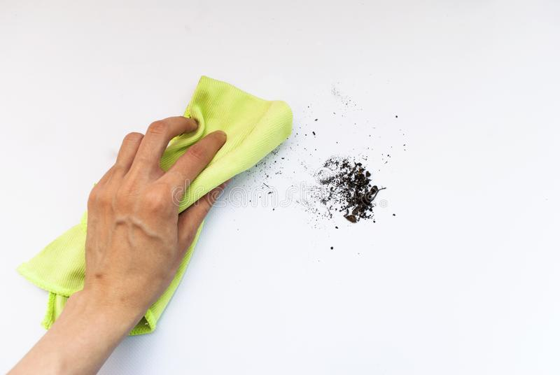 Cleaning agent and gloves on a white background royalty free stock photography