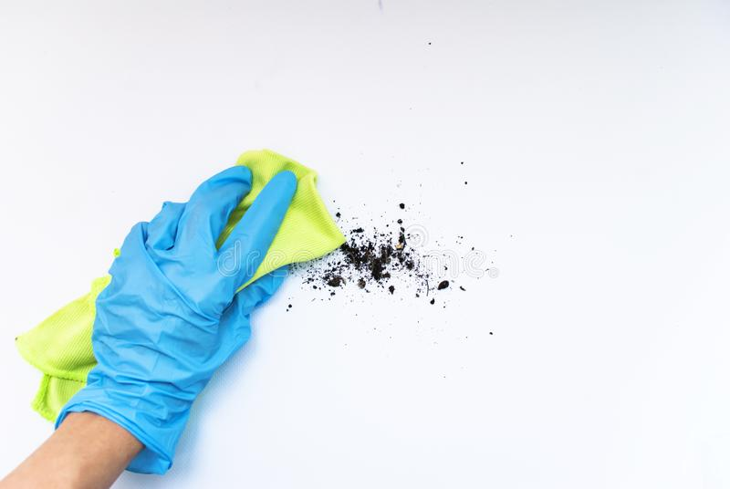 Cleaning agent and gloves on a white background stock photos