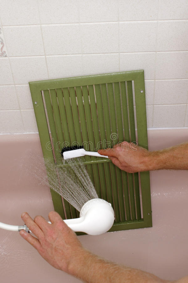 Cleaning an Air Return Vent stock images