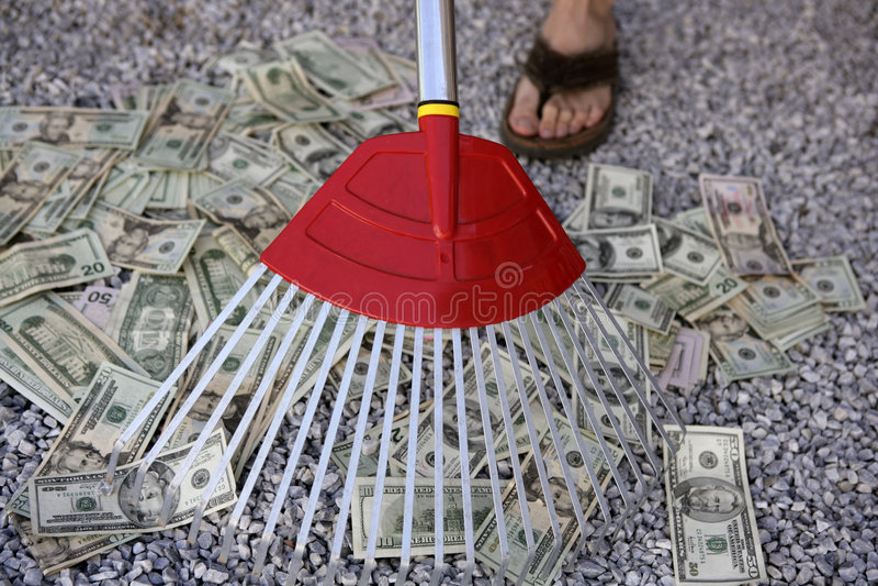 Cleaning black dolar money with rake, metaphor. Of abundance stock images
