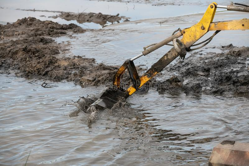 Cleaning the bottom of the lake with a dredge. Machine, pond, water, dredger, industry, machinery, mud, technology, work, ark, auger, barge, boat, boom, broach stock photos