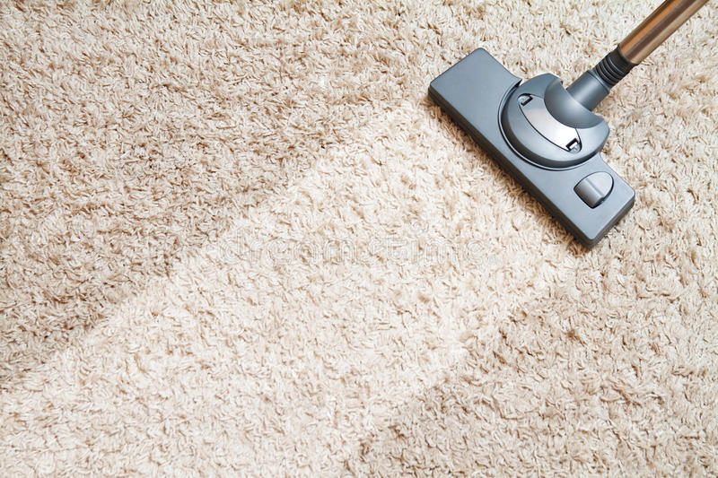 Cleaning carpet hoover. Include the long beige carpet cleaning with a vacuum cleaner royalty free stock image
