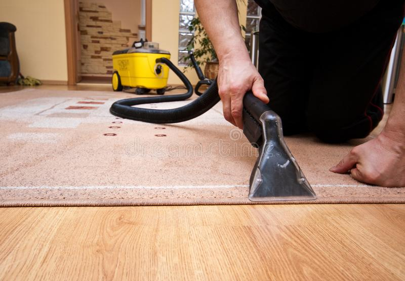 Cleaning carpet services detail with yellow machine royalty free stock photo