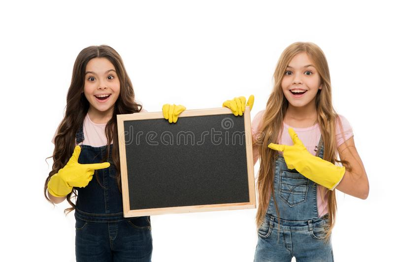 Cleaning check list. Kids cleaning together. Girls with rubber protective gloves ready for cleaning. Household duties. Little helper. Girls cute kids cleaning stock image