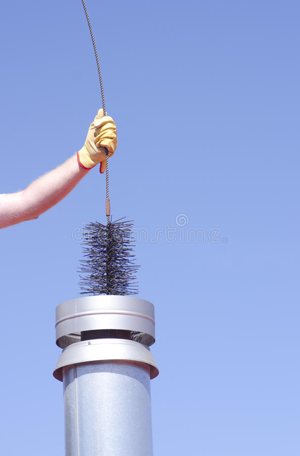 Cleaning chimney with sweeper sky background stock image