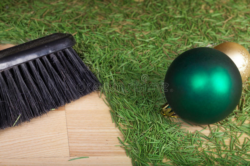 Cleaning after the Christmas party. Cleaning spruce tree needles with brush after the Christmas party royalty free stock photos