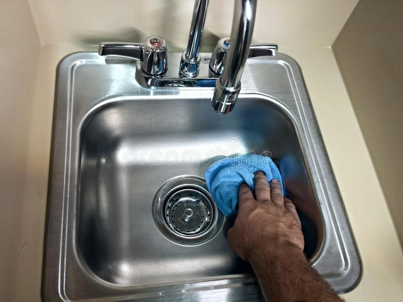 Cleaning Cleaning a sink. This is me cleaning a bathroom sink at home to make sure it's clear of bacteria and gross germs stock images