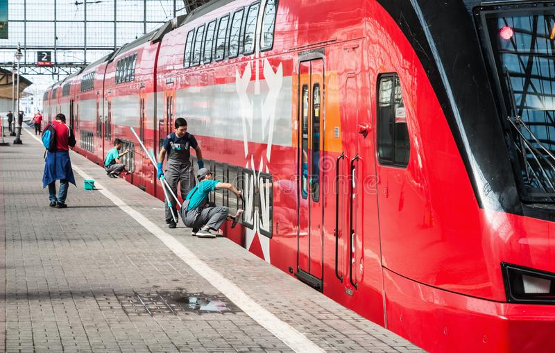 Cleaning company workers are preparing a high-speed train stock photos