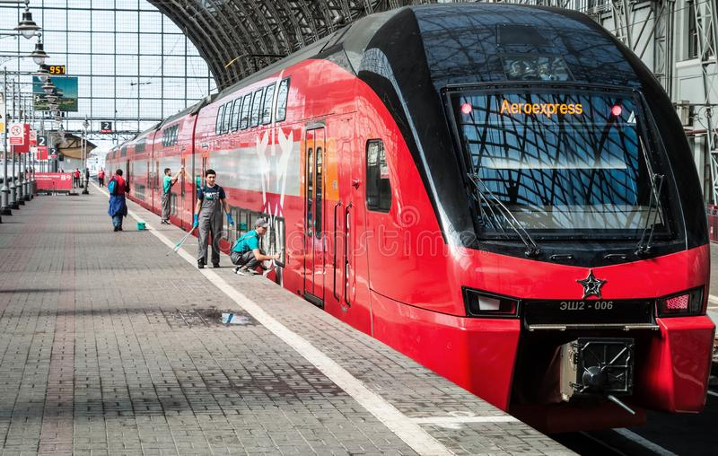 Cleaning company workers are preparing a high-speed train for a trip royalty free stock photography