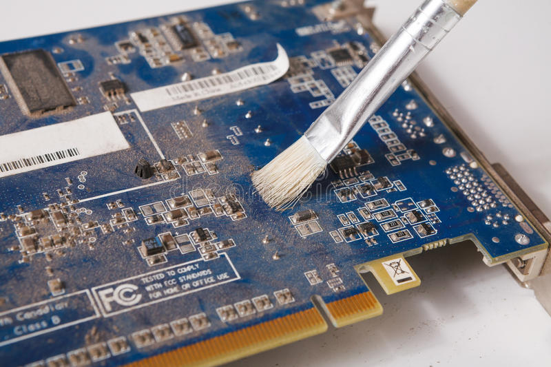 Cleaning computer components close up. Maintenance of electronic parts of computer, repair shop concept royalty free stock photos