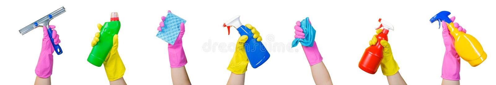 Cleaning concept - hands holding supplies, isolated stock image