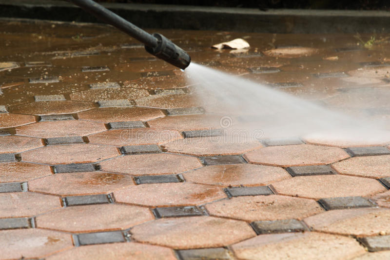 Cleaning concrete block floor. By high pressure water jet stock photos