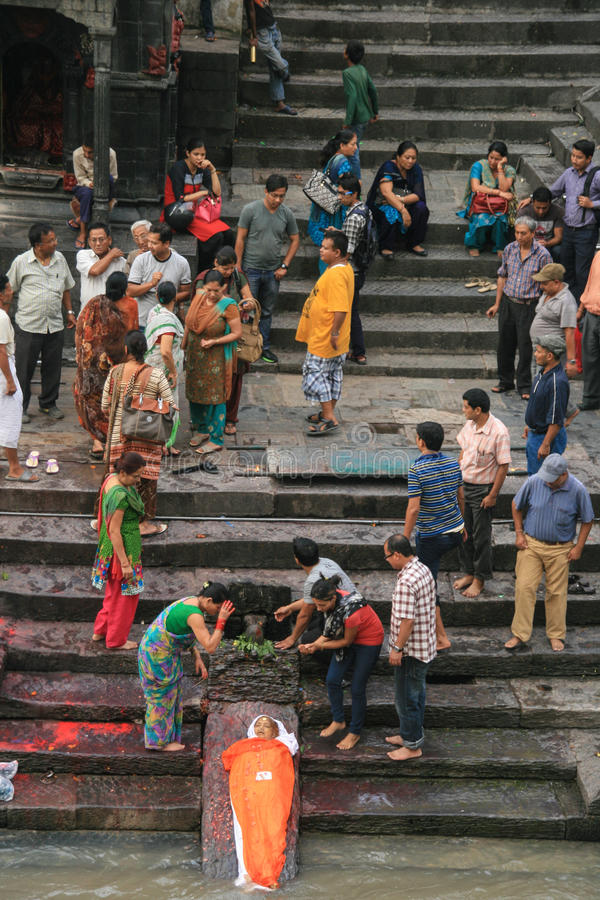 Cleaning the dead to burn in pashupatinath,kathmandu,nepal. Cleaning the dead to burn in pashupatinath is taken in kathmandu,nepal stock photography