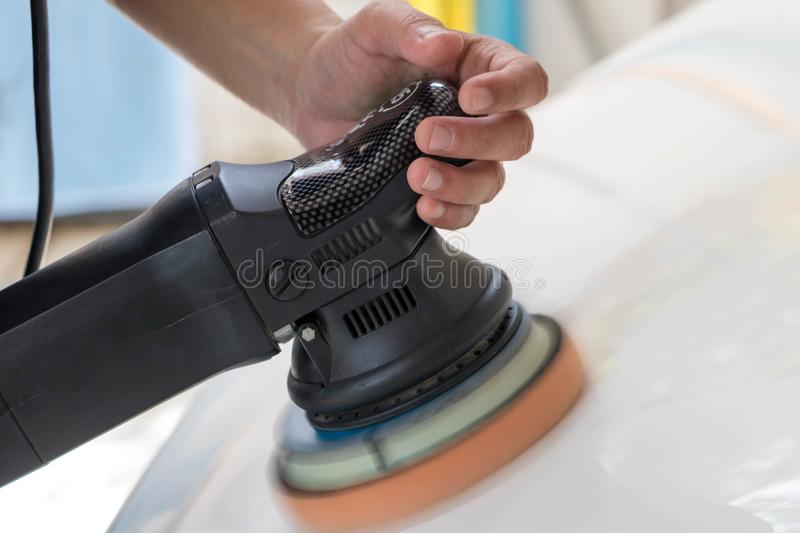 Cleaning and detailing a white car for shiny bangkok Thailand royalty free stock photography