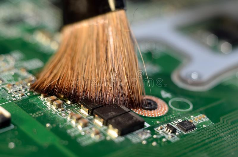 Cleaning the electronic Board with braun brush royalty free stock photography