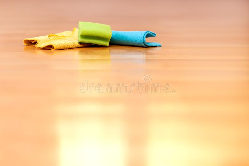 Cleaning equipment like rags or sponge is lying on the floor stock images