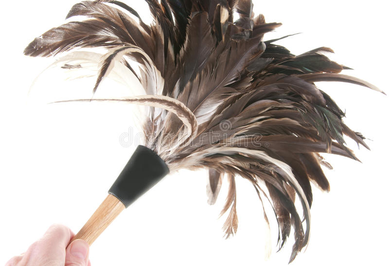 Cleaning with feather duster. Using feather duster to clean royalty free stock photography